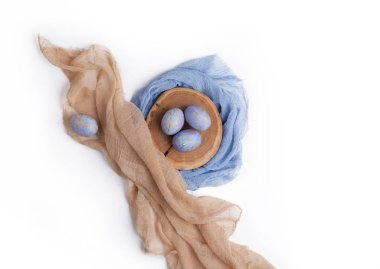 Easter speckled blue eggs with wooden slice