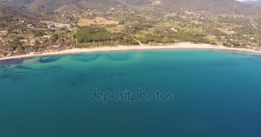 Aerial shot of a beautiful beach on Elba island with its  gorgeous paradisiac sea in Tuscany, Italy, 4K