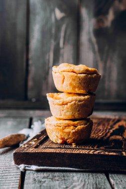 Australian meat pies on wooden table