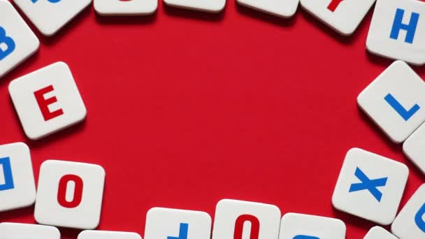 Words SEX made of letters on a red background. Stop motion