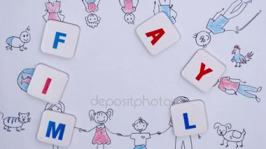 Word family over background of childrens drawing. Stop motion