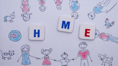 Red and blue letters form the word home on the background of drawing of family.