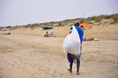 African-american beach vendor in Huelva, Spain