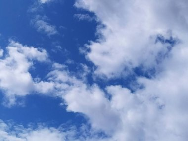 Blue sky background with clouds.