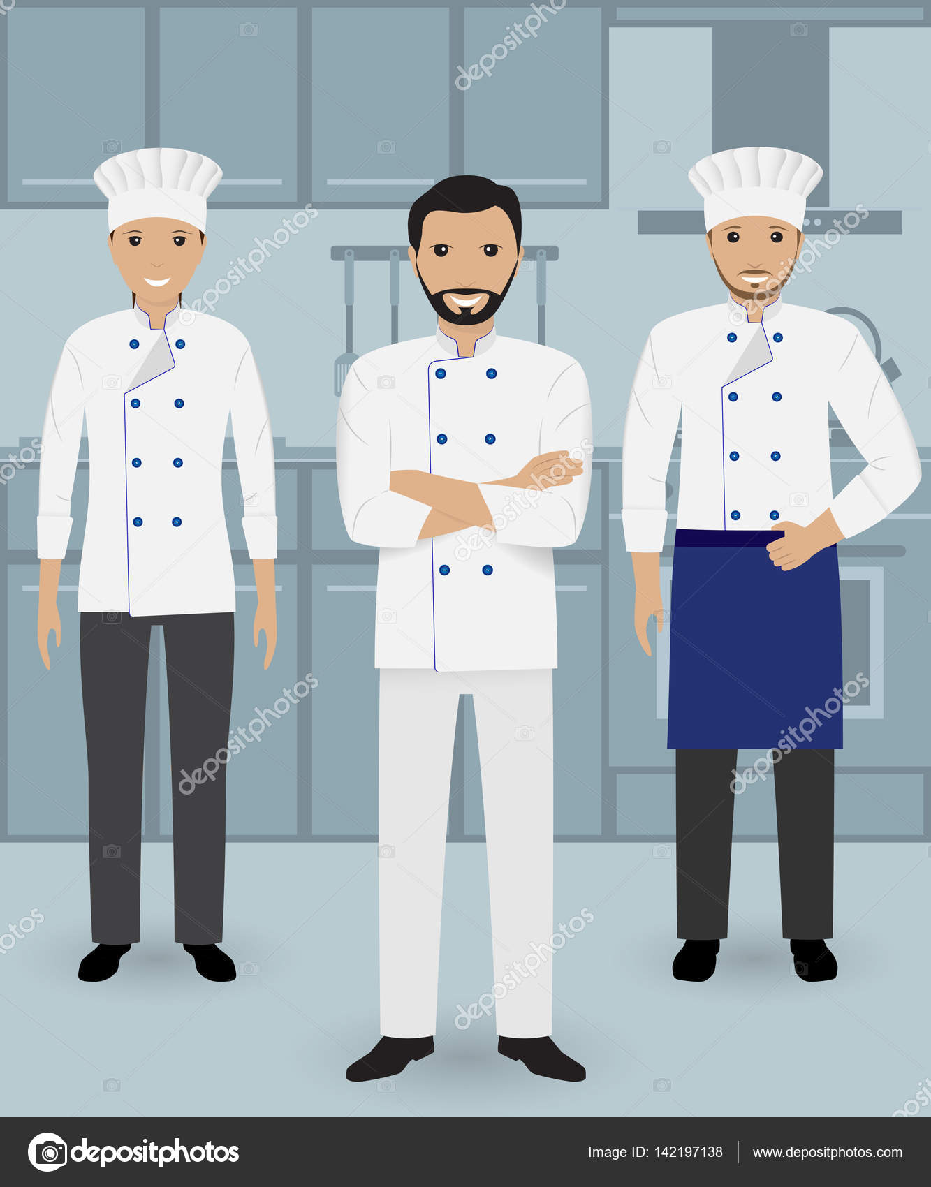 Chef and two cook in uniform standing together on a kitchen ...