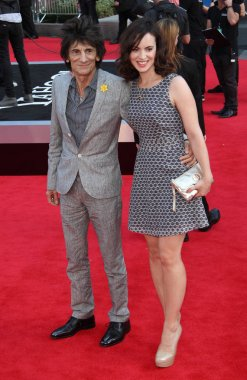 London, UK, 20th August 2013. Ronnie Wood and Sally Wood attend the World Premiere of 'One Direction: This Is Us' at Empire Leicester Square