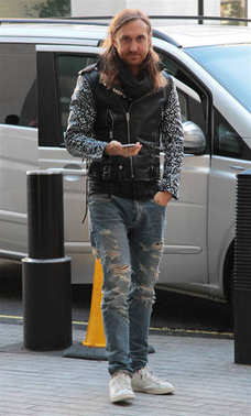 LONDON - OCT 10, 2014: David Guetta seen leaving BBC studios in London