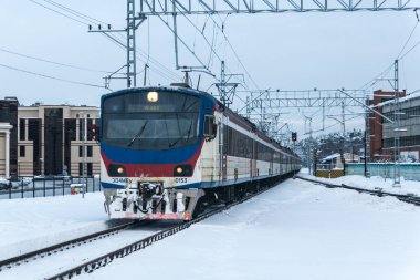 USOVO, MOSCOW REGION, RUSSIA - february 01: Classic Russian suburban train model ED4M arrives at the railway station Usovo