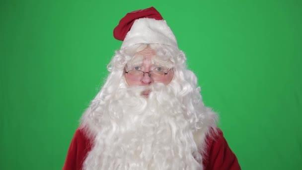 DED marokkói (Santa Claus, Pere Noel) gratulál a Szilveszter és a karácsony. Zöld képernyő chroma-key
