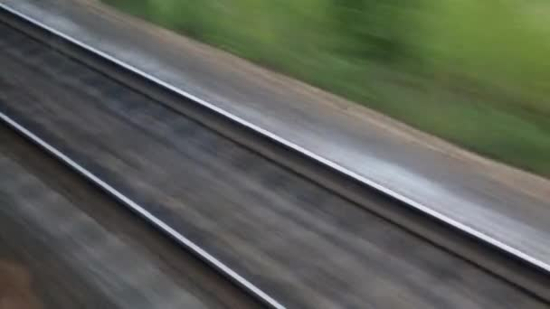 The journey by rail. Shot from the window of a moving train, railroad tracks, rails, sleepers.