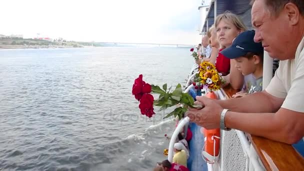 The ships passengers on deck with flowers