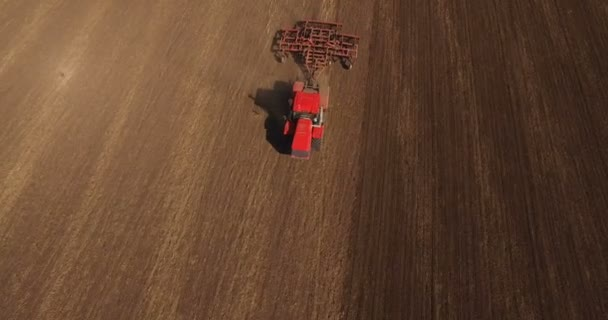 Aerial of tractor on harvest field