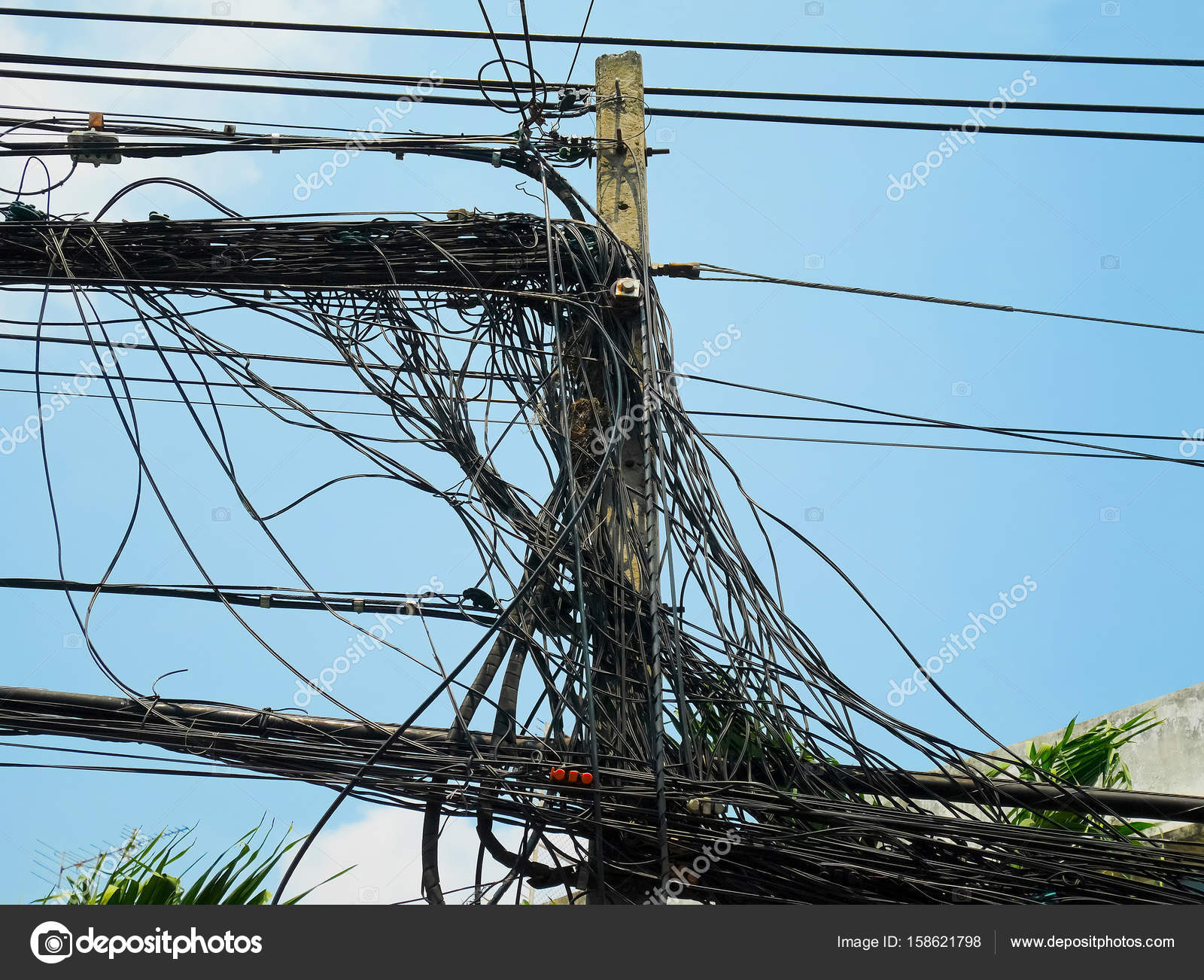 Utility pole supporting messy wires — Stock Photo © p_saranya #158621798