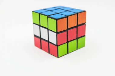 Rubik's cube puzzle on the white background. Cube was invented by a Hungarian architect Erno Rubik in 1974.