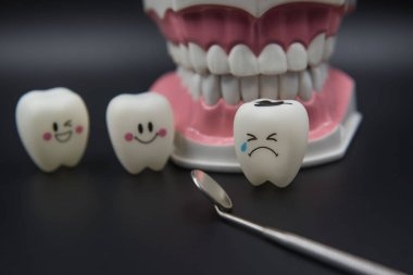 Model Cute toys teeth in dentistry on a black background