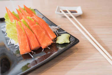 Crab stick with wasabi and soy on table japanese food