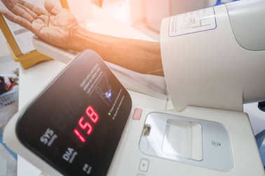 checking the blood pressure in the hospital with a digital equipment