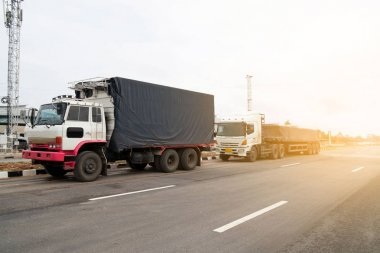 trucks Logistic by Cargo truck Import Export business and Industrial on the road .