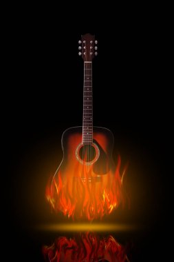 Acoustic guitar on fire on black background