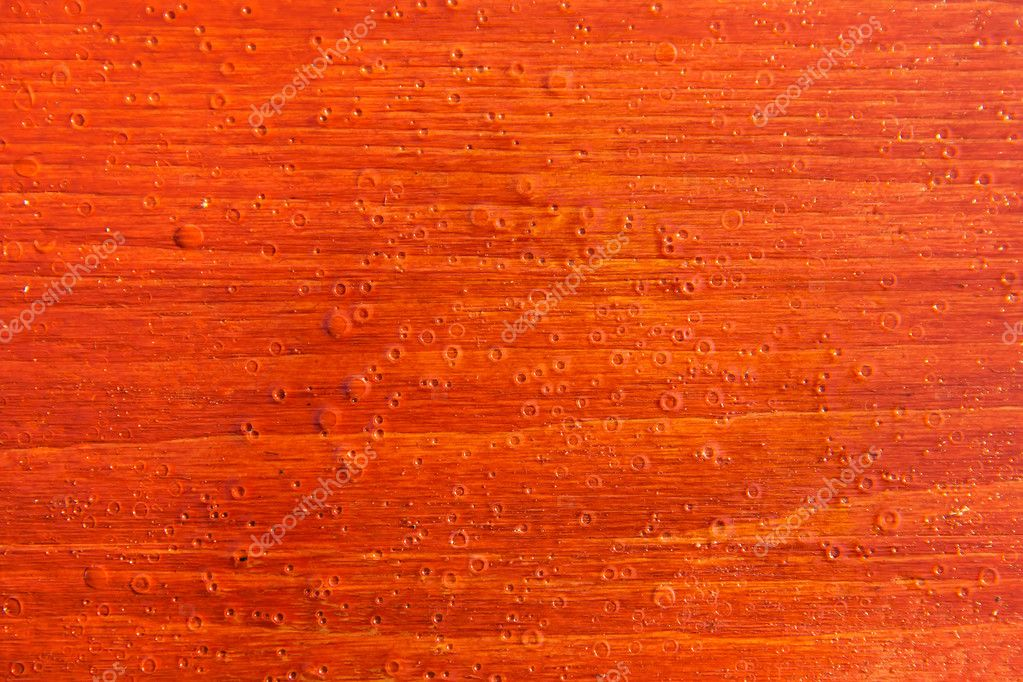 Red wood lacquer board texture with rain drops — Stock Photo