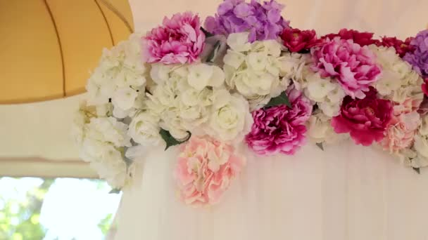 Flowers in wedding decor. Pink and white peonies.