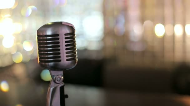 Beautiful vintage microphone In the interior of the cafe. Retro microphone on a bright background. Slow motion.