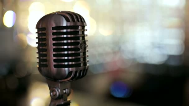 Vintage microphone against a bright background. Microphone. Slow motion.