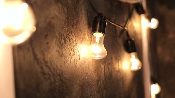 A row of light bulbs in Christmas decor. Group of Light bulb. Selective focus. Lighting Decor.