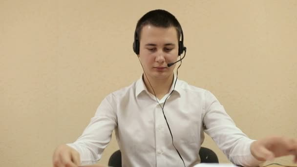 The employee call center reviews documents. Call center operators at work.