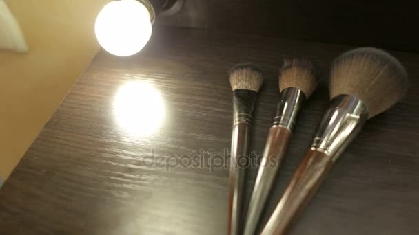 Make-up Brushes. Professional make-up brushes on a brown table in the dressing room. Beauty salon.