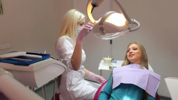 Beautiful young girl in the dental clinic. Dentistry.