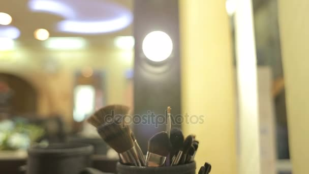 Professional make-up brushes in tube. Make-up set. Beauty salon.