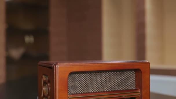 Vintage Radio on wooden table is in the vintage room.