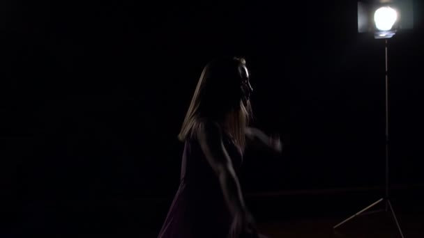 Beautiful girl ballet dancer on a black background