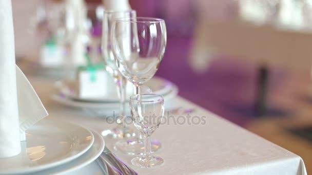 Glasses of wine set on restaurant table.