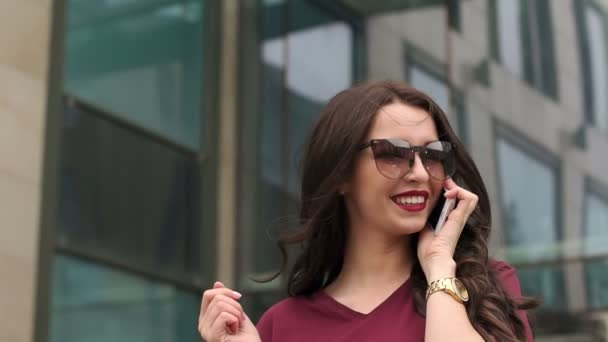 Girl hipster with phone near the modern building.