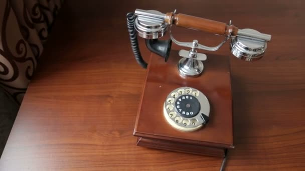 Vintage brown phone on old wooden table background