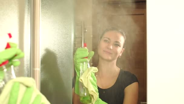 Maid In Gloves Cleans A Mirror In The Bathroom Stock Video - Bathroom maid