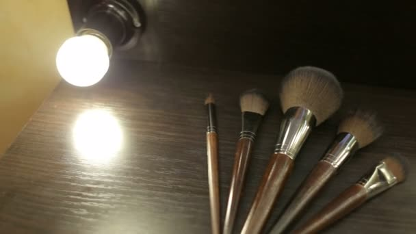 Close-up of five make-up brushes on the table