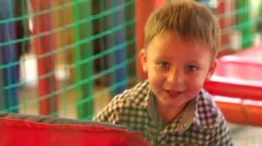 Cute boy having fun at entertaining center.