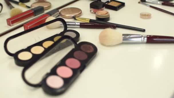 Set of cosmetics for make-up on a white table.