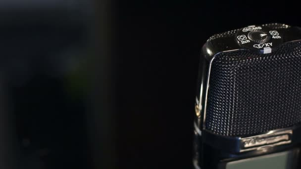 Close-up of a microphone to record sound on black.