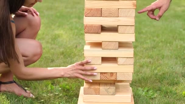 Girl playing a giant game in the Park.