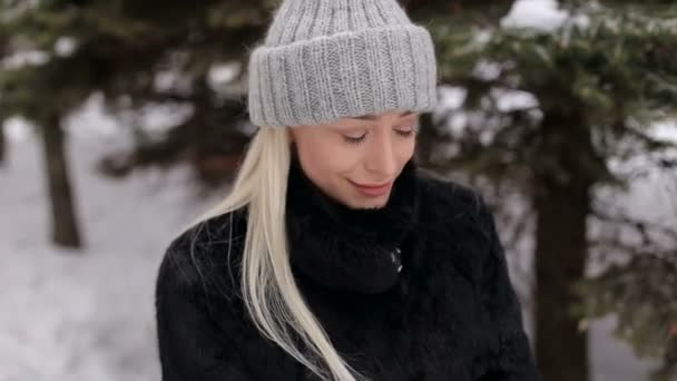 Portrait of a beautiful blonde in winter outdoors.