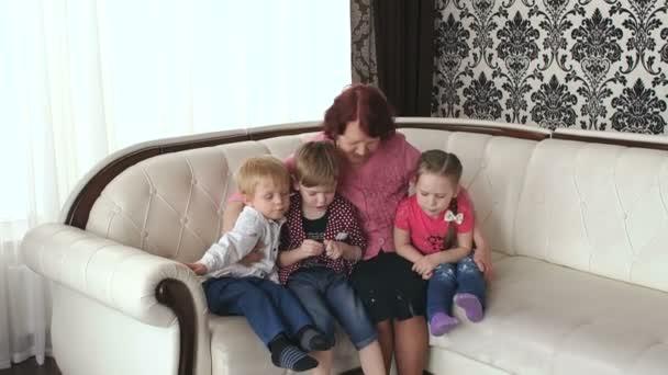 Happy grandmother hugging with her grandchildren.