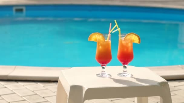 Close-up of two refreshing cocktail by the pool.