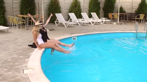 Two girls Teens having fun in the pool on vacation