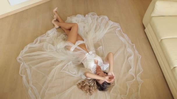 Sexy girl in lingerie lying on the floor.