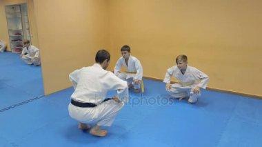 Martial arts instructor training children. Aikido.