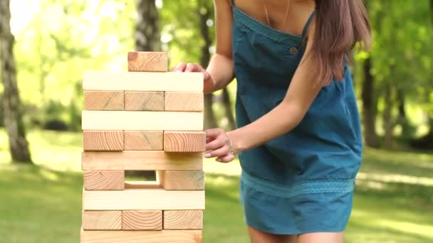 People playing Jenga game in the Park.